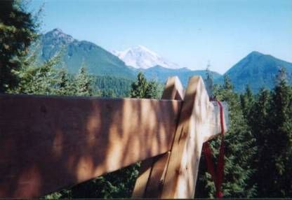 View of Mt. Rainier and nearby peaks from the loft area at 100 feet above the ground.  (Wooden beam for hoisting operation is in foreground.)